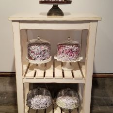 Kristine Schomaker Let Me Eat Cake Glass cake stands, shredded letters and pages from journal, wood baking shelves 24x36x72 inches https://www.kristineschomaker.net/