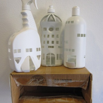 "Hilary Norcliffe A Home for Curtis (2010) Detergent bottles, cardboard box 17"" x 11"" x 5"" http://hilarynorcliffe.com/"