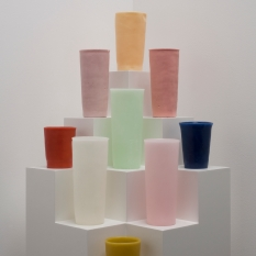 George Stoll Untitled (9 tumblers on a stepped corner pyramid) 2011 beeswax, paraffin, pigment, plywood and paint 64 3/4 x 12 x 12 inches https://www.georgestoll.net/